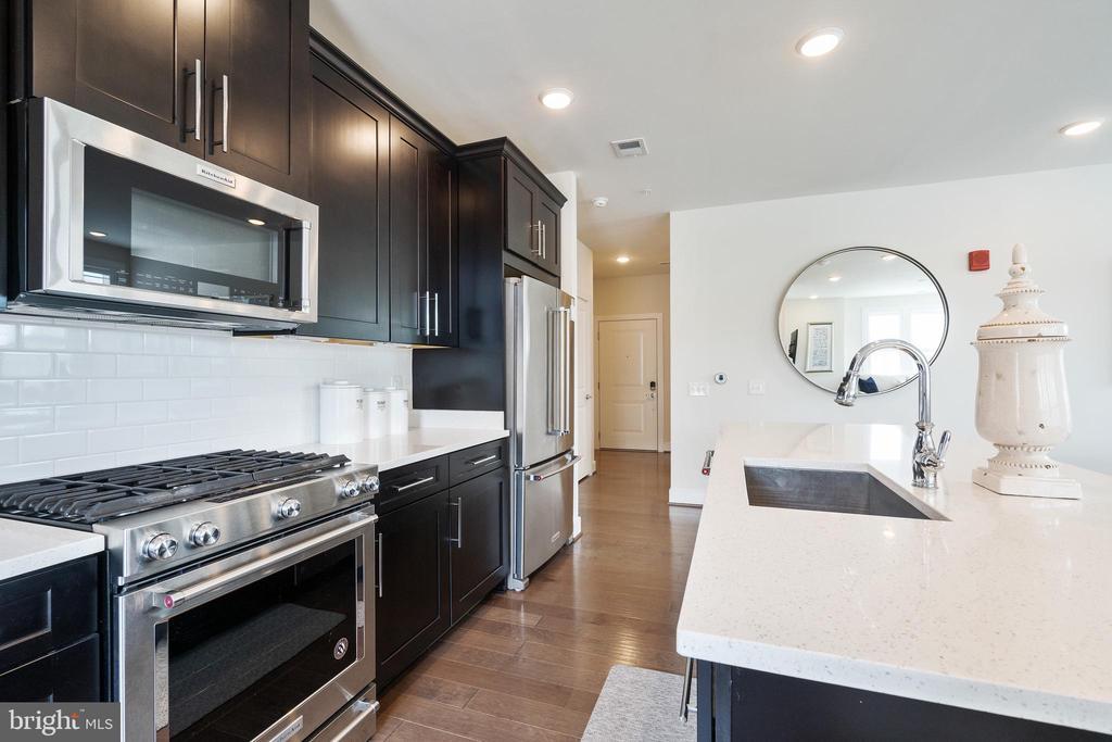Kitchen view from corner - 11200 RESTON STATION BLVD #301, RESTON