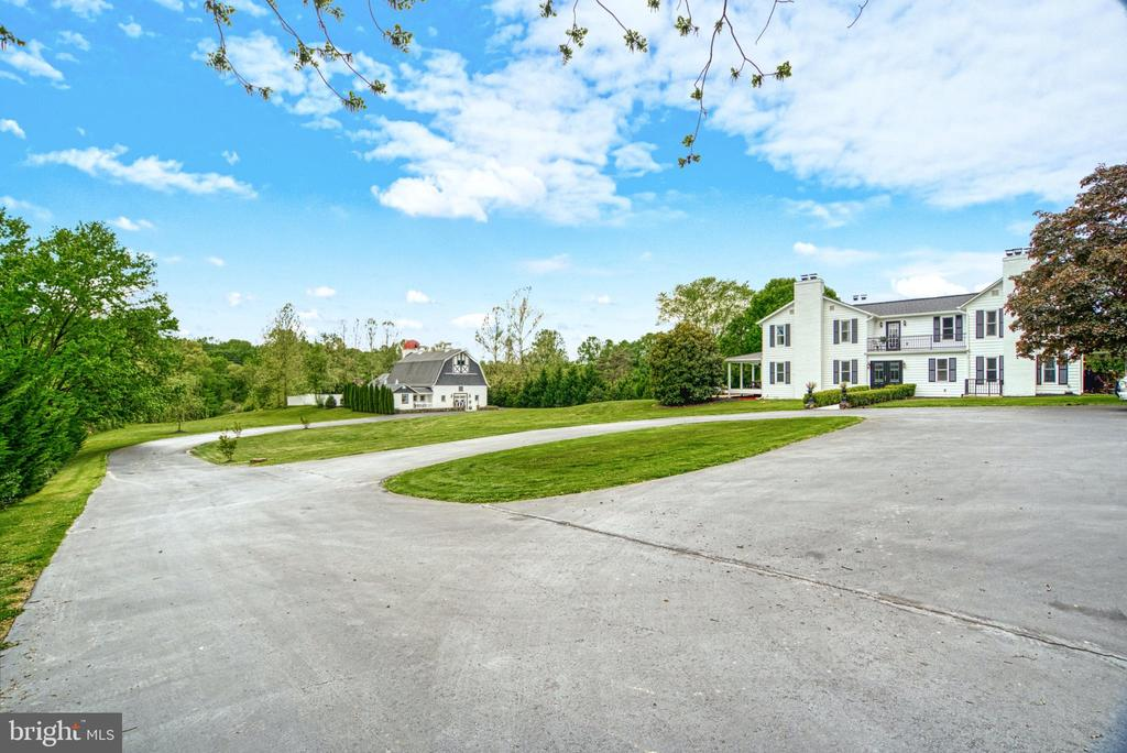 12,000 sq.ft. Compound. Paved parking for 40+ cars - 7500 CLIFTON RD, CLIFTON