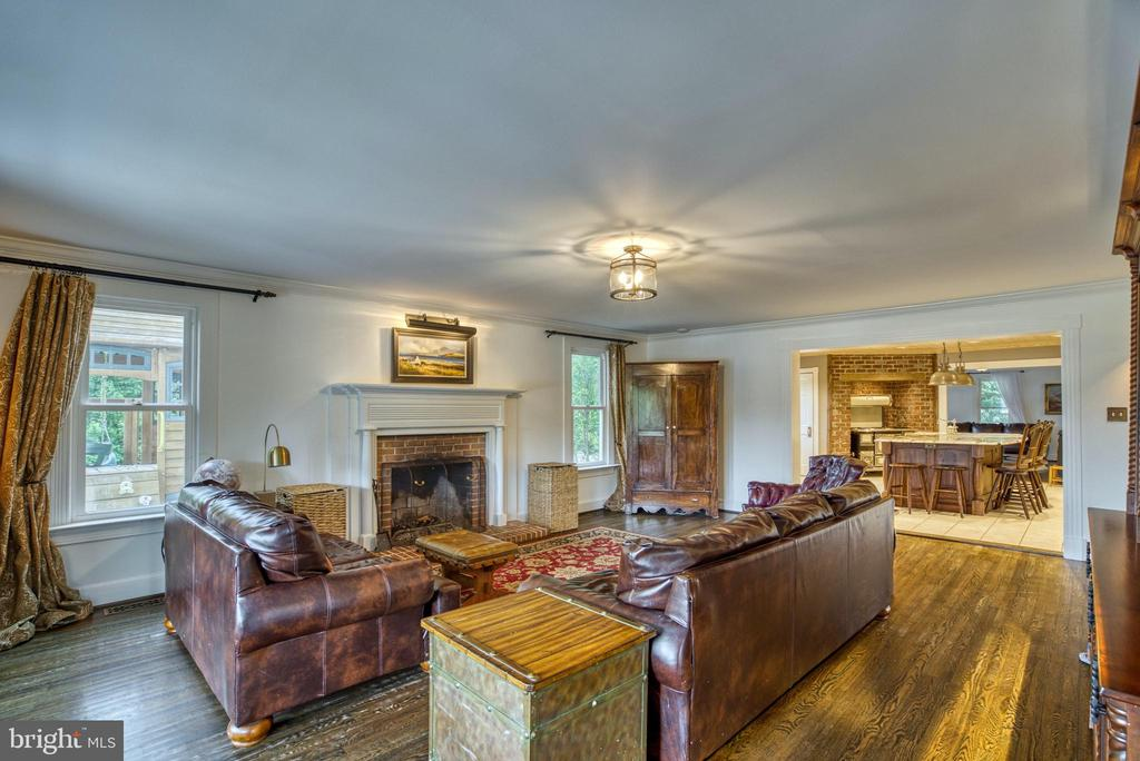 Family room off kitchen. Wood-burning fireplace. - 7500 CLIFTON RD, CLIFTON