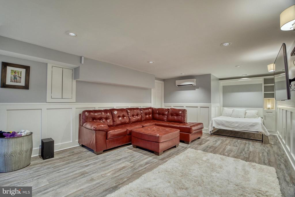 Basement with LVT floors and Murphy bed. - 7500 CLIFTON RD, CLIFTON