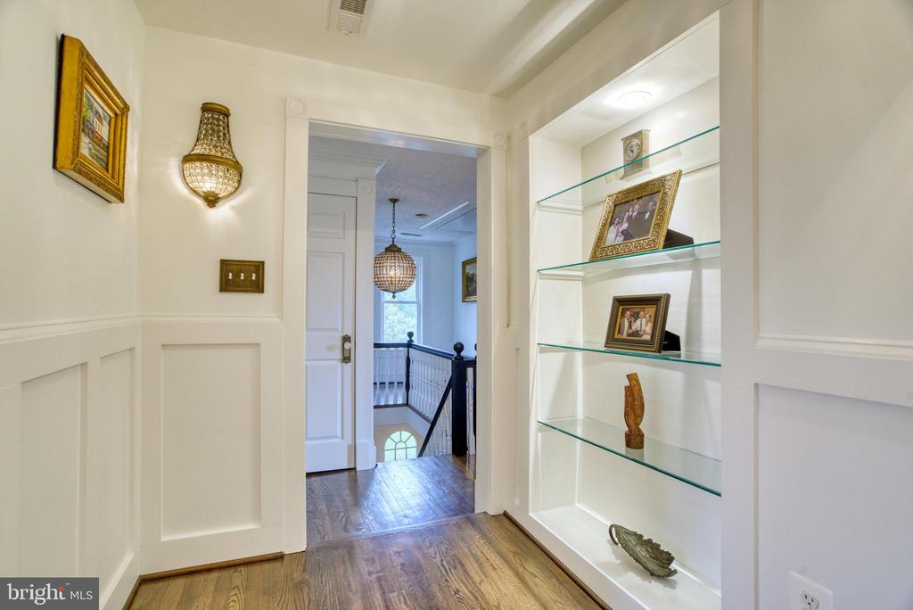 Upper hallways with lighted shelving - 7500 CLIFTON RD, CLIFTON