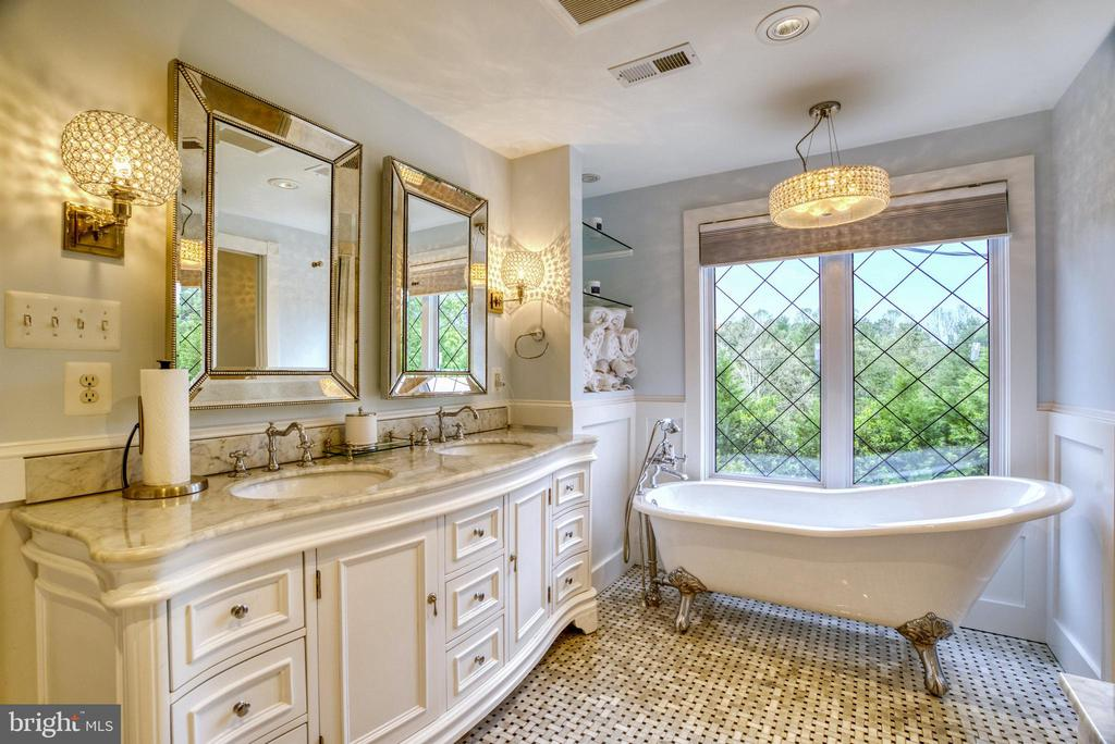 Dual vanity with Carrera marble top. - 7500 CLIFTON RD, CLIFTON