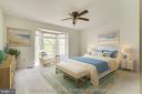 The large primary bedroom features bay windows - 14707 KAMPUTA DR, CENTREVILLE