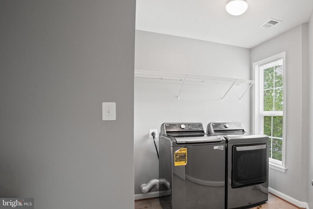 Convenient and sizable upstairs laundry room!! - 41959 ZIRCON DR, ALDIE