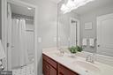 Roomy hall bath has dual sinks, separate tub area. - 41959 ZIRCON DR, ALDIE