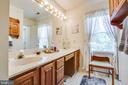 Master bath with dual sinks and natural light! - 10908 C E O CT, FREDERICKSBURG