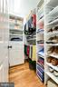 Two of two walk in closets in primary suite - 1904 MALLINSON WAY, ALEXANDRIA