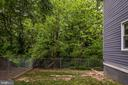 Fenced yard backing to trees - 16187 BALTIC PL, KING GEORGE