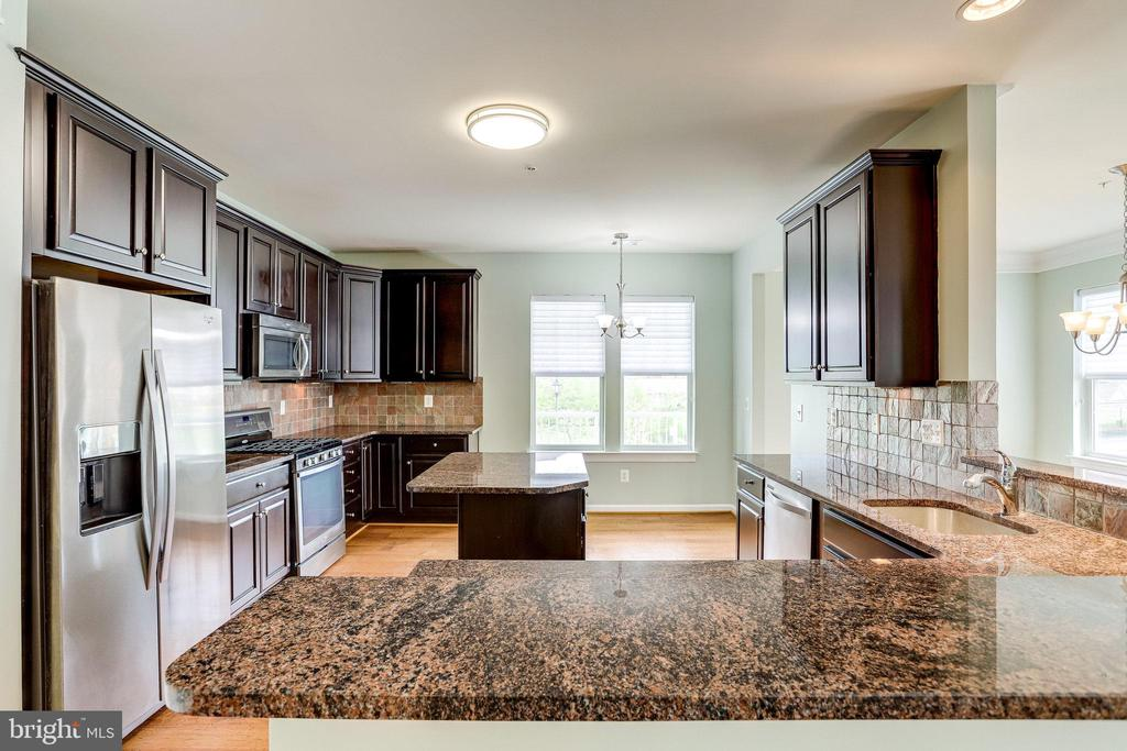 Kitchen from the Great Room - 20580 HOPE SPRING TER #207, ASHBURN