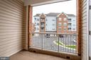 Look out onto the Common area with Benches - 20580 HOPE SPRING TER #207, ASHBURN