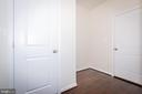 Mudroom going into garage to left and coat closet. - 502 APRICOT ST, STAFFORD