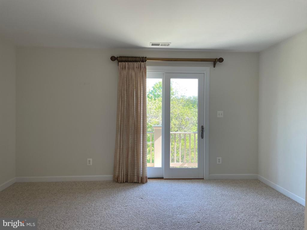Bedroom #2 with door to deck and private bath - 126 N JAY ST, MIDDLEBURG