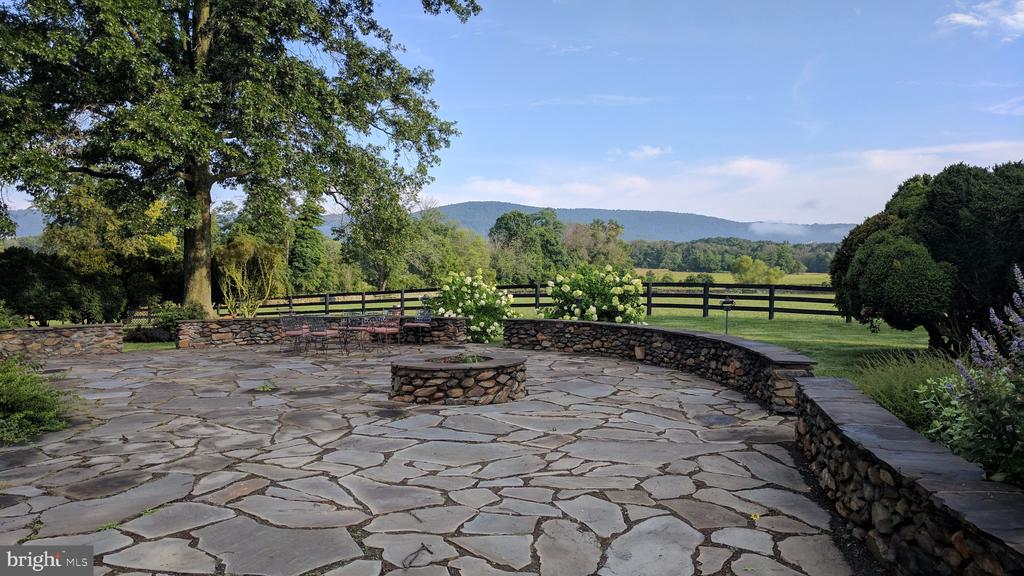 Stone patio with fire pit and wall off kitchen - 20775 AIRMONT RD, BLUEMONT