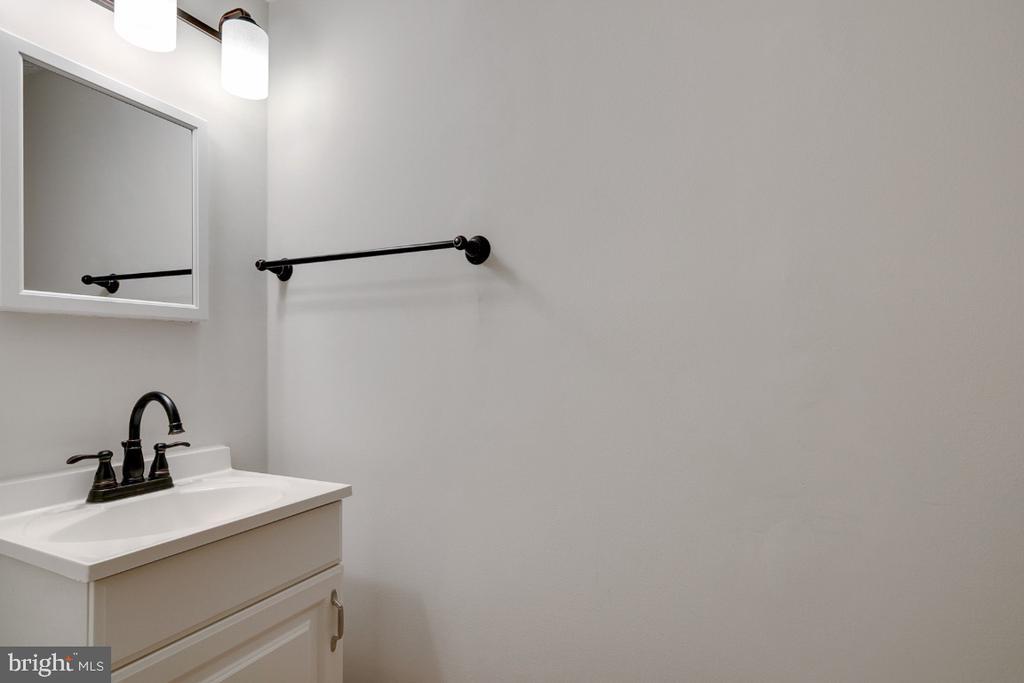Lower level powder room - 8444 SUGAR CREEK LN, SPRINGFIELD