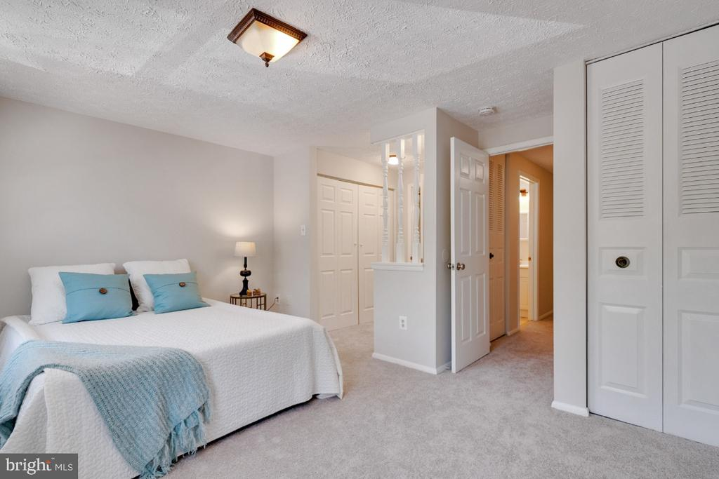 Primary bedroom with dressing area and 3 closets - 8444 SUGAR CREEK LN, SPRINGFIELD