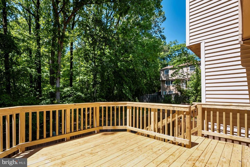 Deck backs to woods, stairs to lower yard - 8444 SUGAR CREEK LN, SPRINGFIELD