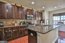 Kitchen with granite and backsplash - 42810 LAUDER TER, ASHBURN