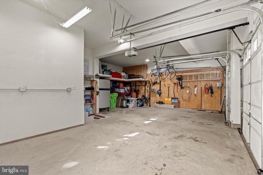 Three Car Garage with Large Storage Shelf - 43327 RIVERPOINT DR, LEESBURG