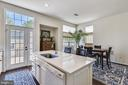 Bright kitchen opens to patio and leads to garage. - 43533 MINK MEADOWS ST, CHANTILLY