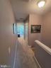 Hallway from 2nd Master w/Laundry - 11755 TOLSON PL #11755, WOODBRIDGE