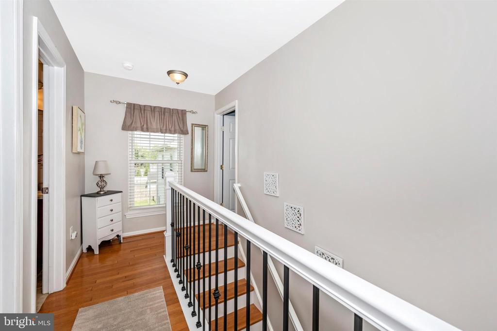 Upper level  hall & stairs with  hardwood  floors - 17004 INDIAN GRASS DR, GERMANTOWN