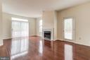 Family Room with doors leading to wrap around deck - 44257 MOSSY BROOK SQ, ASHBURN