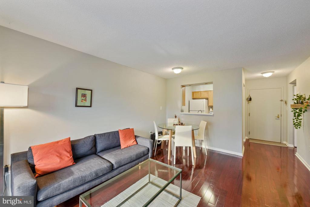 Living room looking towards dining area. - 2111 WISCONSIN AVENUE, NW #420, WASHINGTON