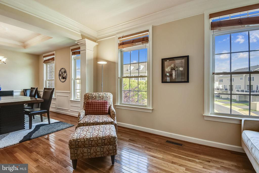Living room into the dining room - 24953 EARLSFORD DR, CHANTILLY