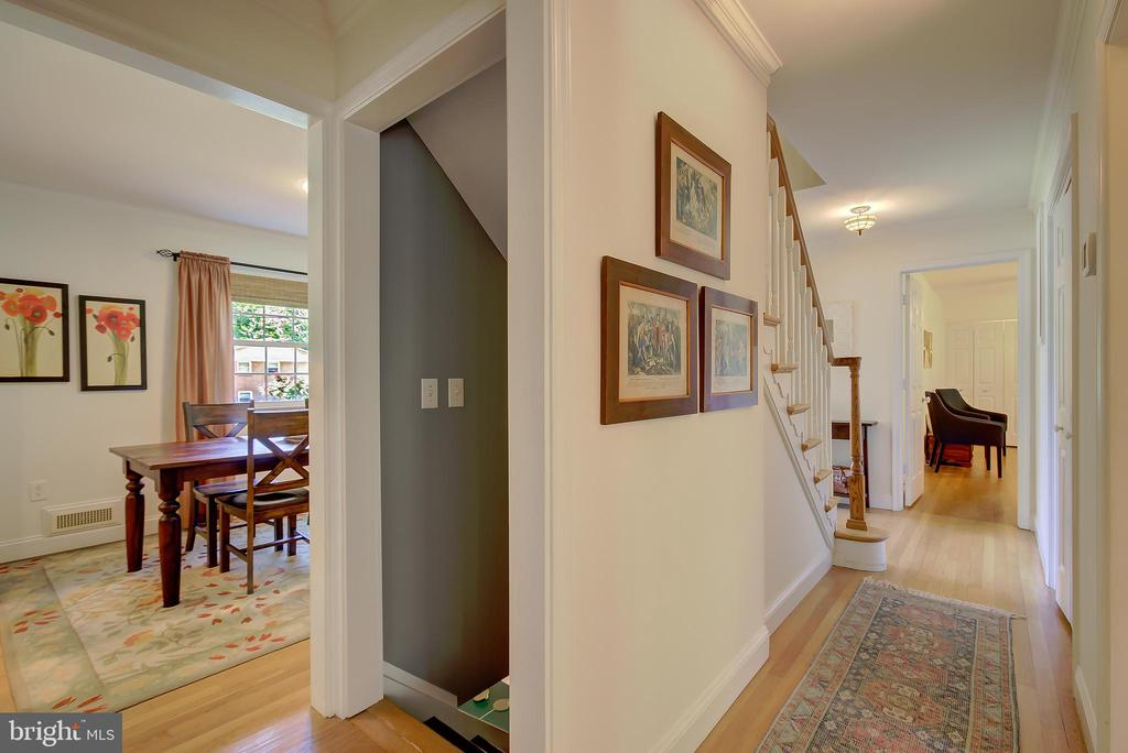 Main Level Hallway and Stairs to Lower Level - 2502 CHILDS LN, ALEXANDRIA