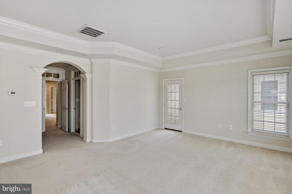 Master bedroom with private balcony - 24905 EARLSFORD DR, CHANTILLY