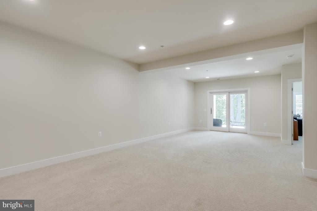 Walk-out Lower Level w/ neutral textured carpet - 9754 KNOWLEDGE DR, LAUREL