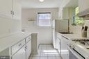 Kitchen with Corian counters and tiled floors - 2415 EVANS DR, SILVER SPRING