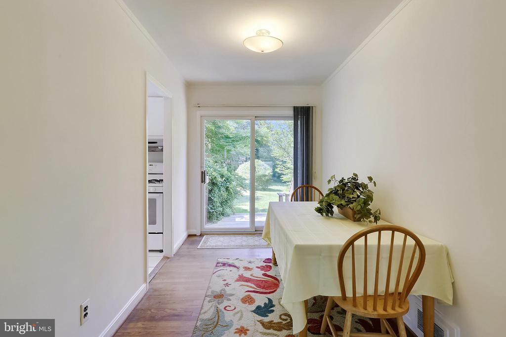 Dining Room with sliding glass doors to rear yard - 2415 EVANS DR, SILVER SPRING