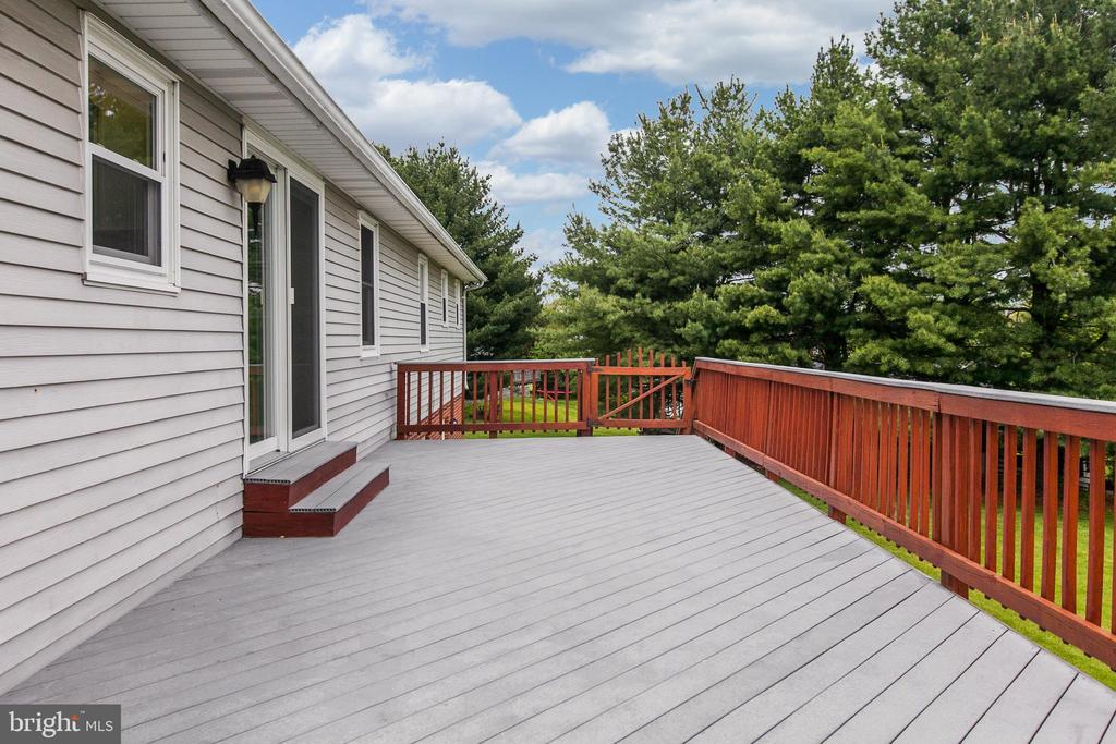 Deck off kitchen Pic 1 - 7517 PICNIC WOODS RD, MIDDLETOWN
