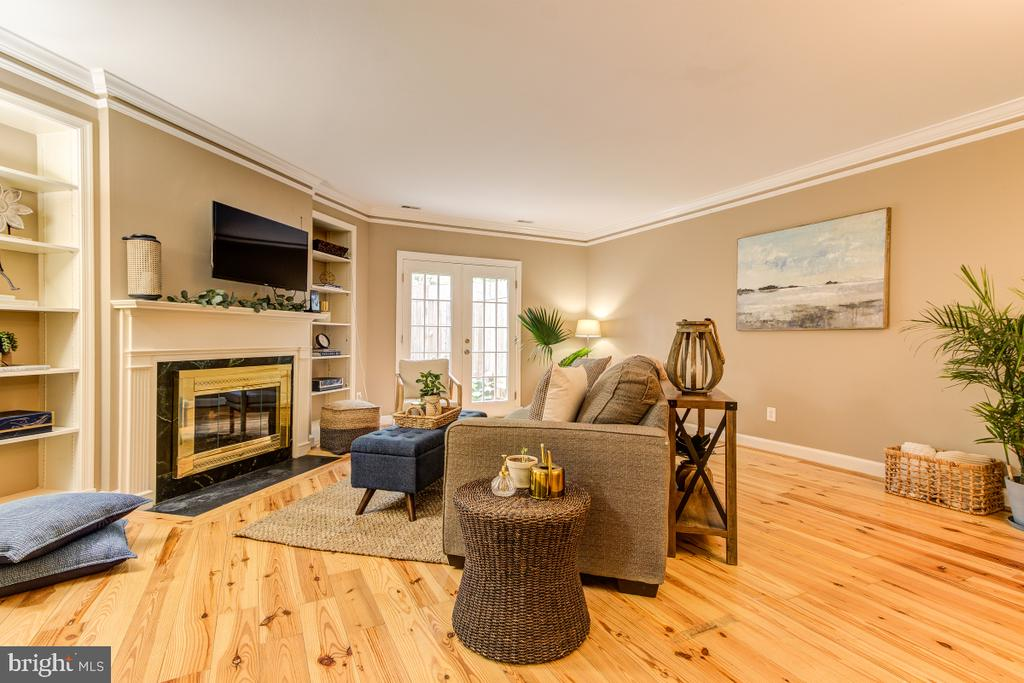 Living room 1  with built ins and fireplace - 4345 MASSACHUSETTS AVE NW #4345, WASHINGTON