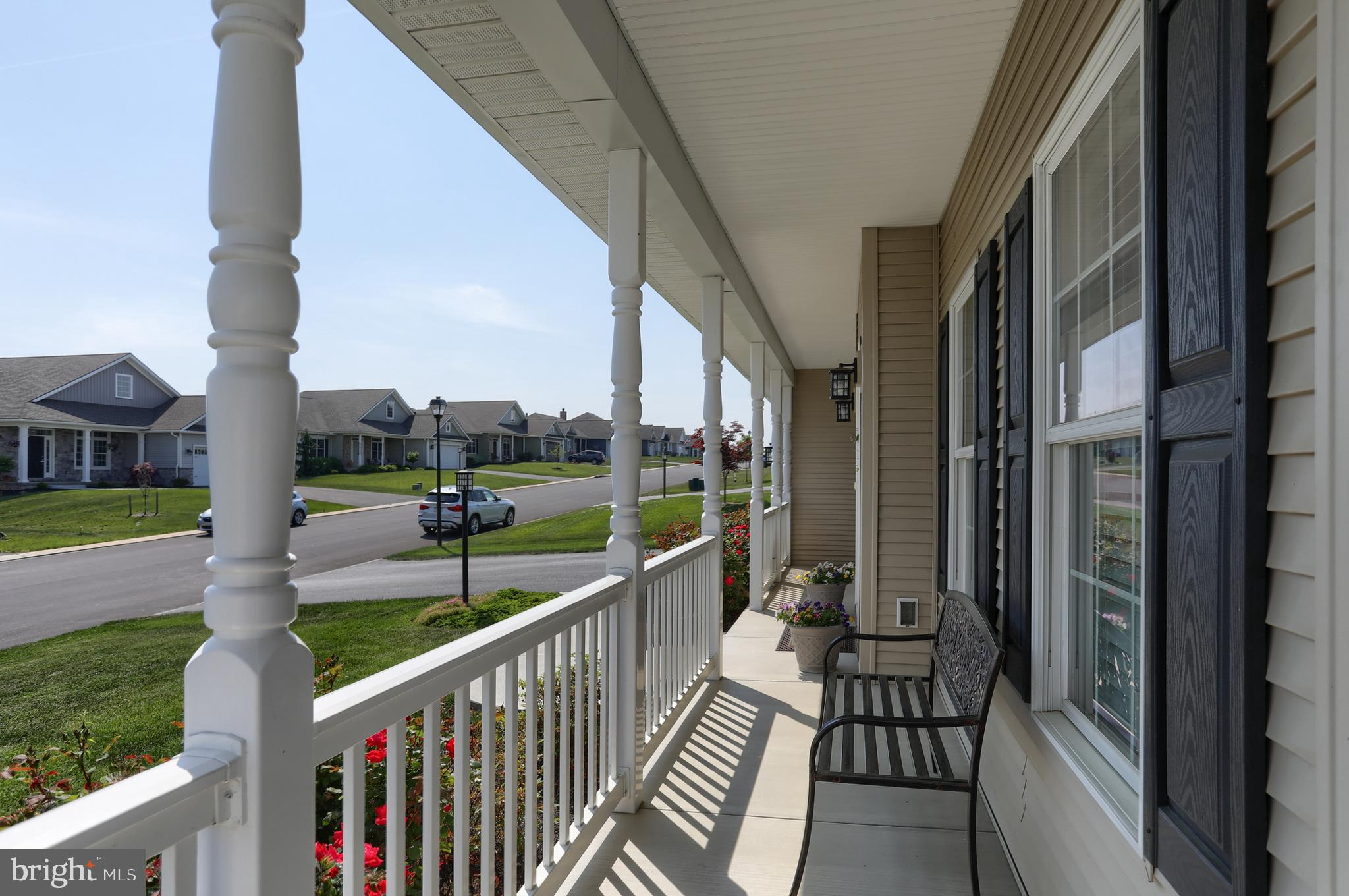 Large farmhouse porch with railing