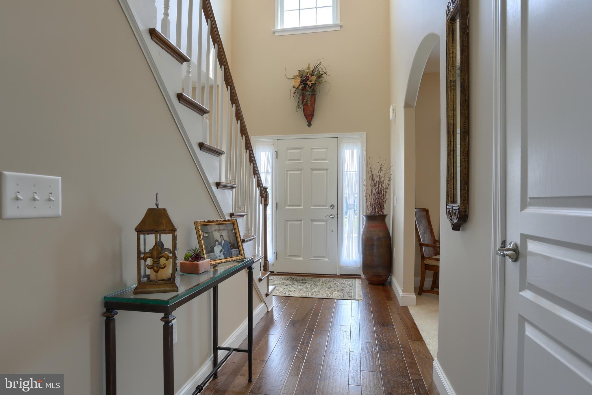 2 story foyer with hardwood flooring