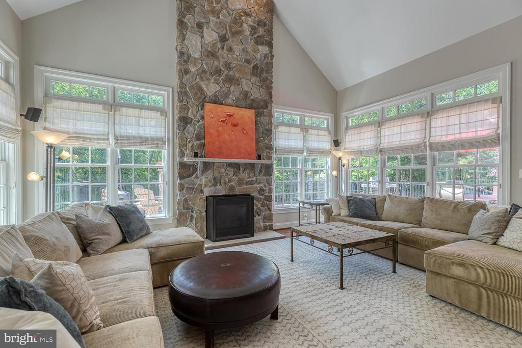 Two-story family room with stone gas fireplace. - 42091 NOLEN CT, LEESBURG