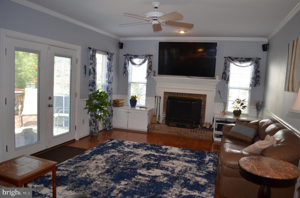 New French doors lead to deck - 6304 SPRING FOREST RD, FREDERICK