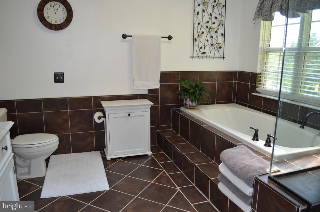 Updated luxurious bath with soaking tub - 6304 SPRING FOREST RD, FREDERICK
