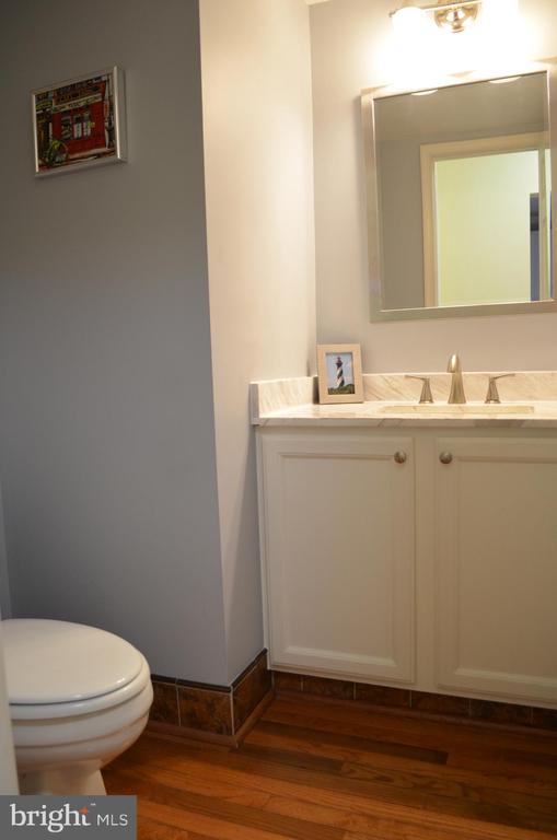 Half bath with hardwood main level - 6304 SPRING FOREST RD, FREDERICK