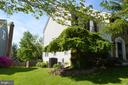Side yard with beautiful landscaping - 6304 SPRING FOREST RD, FREDERICK