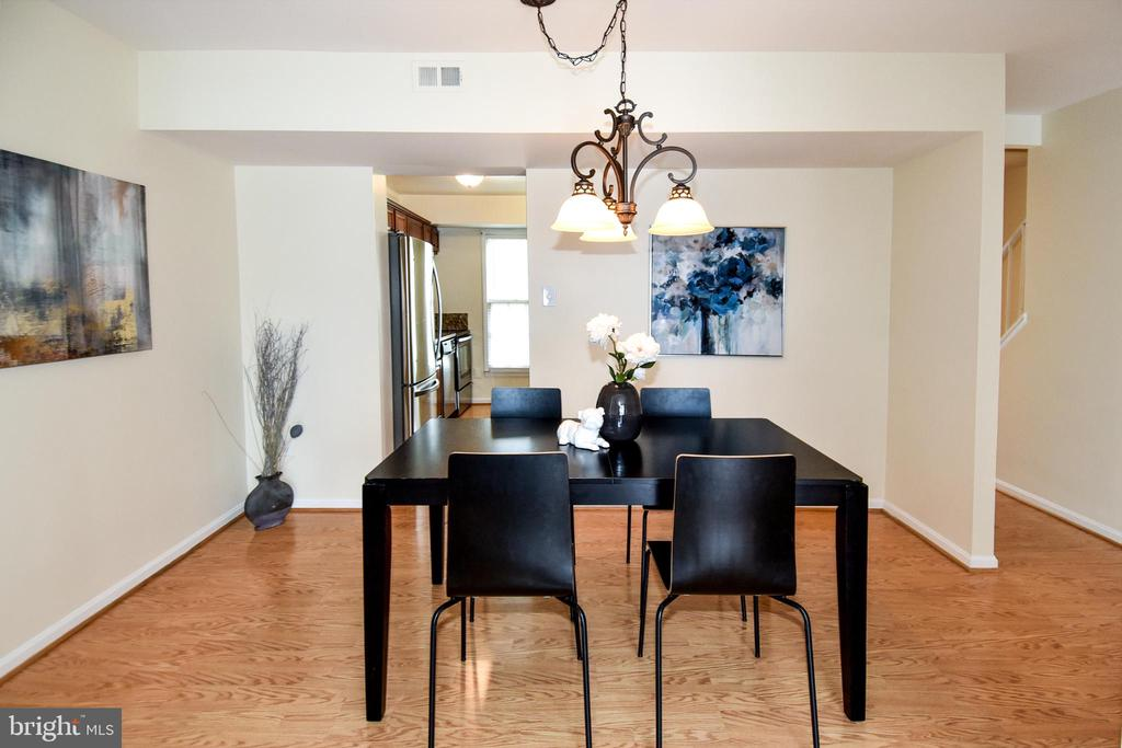 A formal dining room space. - 6463 FENESTRA CT #50C, BURKE