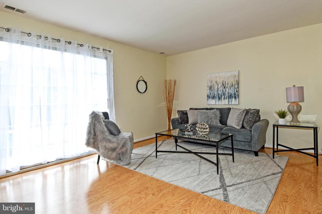 Family room is  full of natural light! - 6463 FENESTRA CT #50C, BURKE