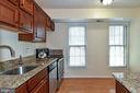 Two windows make the kitchen bright and sunny. - 6463 FENESTRA CT #50C, BURKE