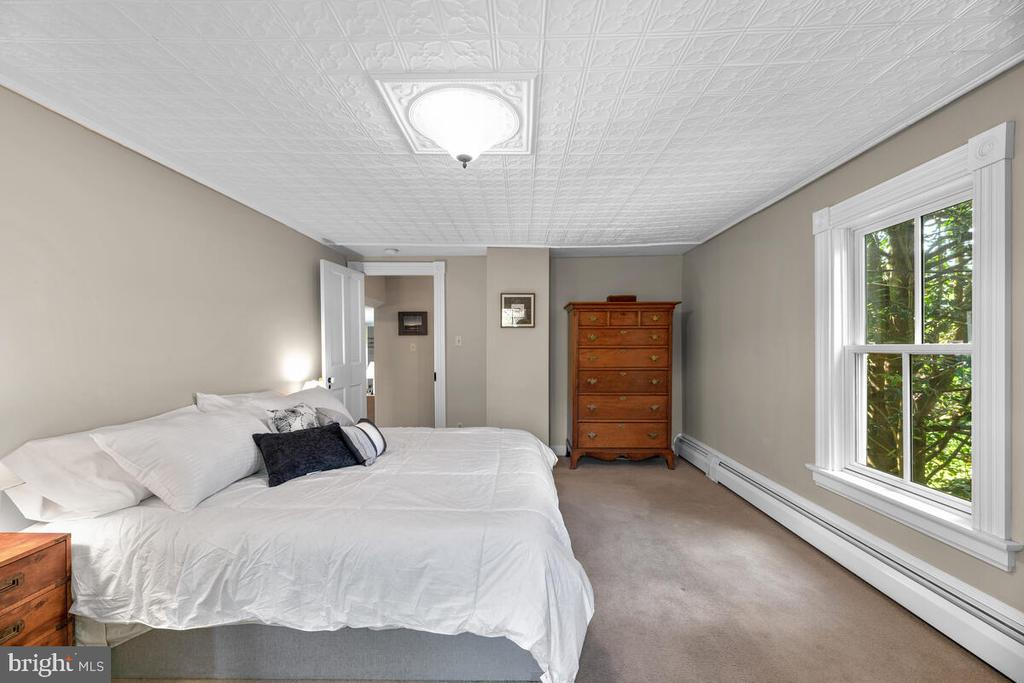 Primary bedroom with tin ceiling - 12645 OLD FREDERICK RD, SYKESVILLE