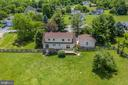 Arial shots of the lush and large back yard - 102 CHRISTOPHER CT, CHARLES TOWN