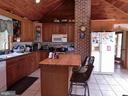 Rustic Kitchen With a butcher Block Topped Island - 420 RUSSELL RD, BERRYVILLE
