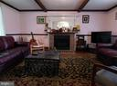 Living Room with Beamed Ceiling - 420 RUSSELL RD, BERRYVILLE