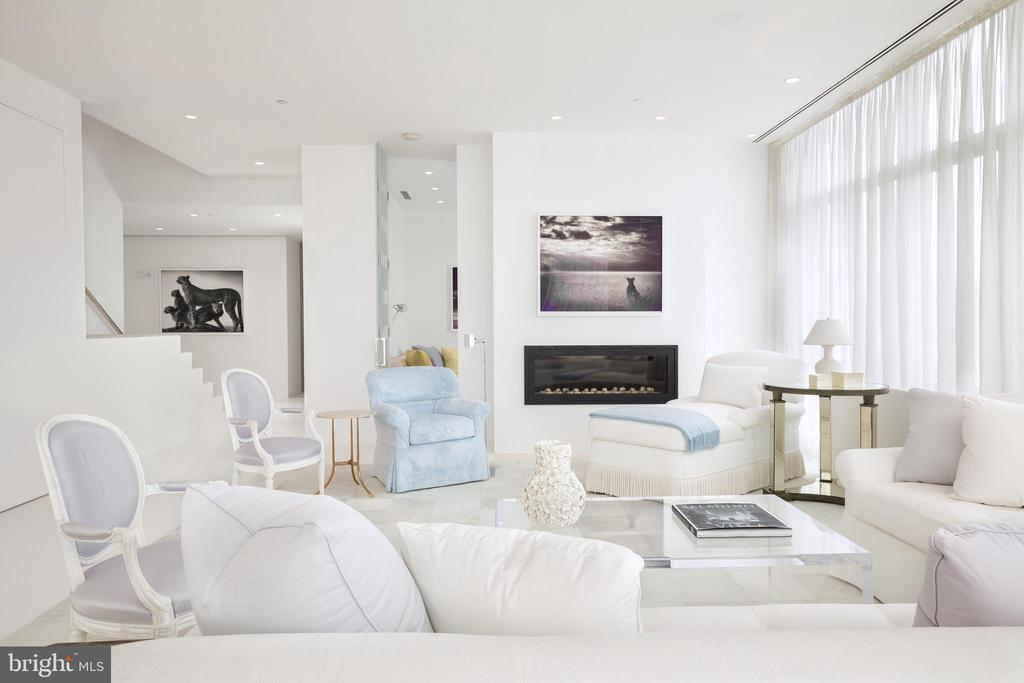 A modern gas fireplace anchors the living room - 1177 22ND ST NW #9G, WASHINGTON